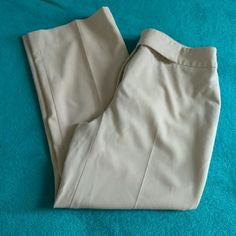 Khaki Capri ***like new Has a creases down the front and back of the leg for a professional look without ironing!! Short enough to show off a cute pair of shoes.  Condition is like new. Hardly worn. Apostrophe Pants Capris