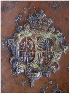 Detail of the arms of Marie Antoinette (as dauphine) on a book.