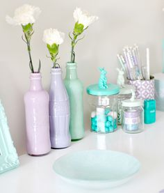 Coke bottles painted in pretty pastel colors for adorable vases -I'm going to do this, my son collects coke bottles and now I know what to do with them!