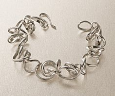 Sterling silver is beautifully hand fabricated into delicate coils, joined together to create this dynamic bracelet.