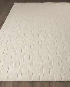 Freshly appealing with its textural design of geometric shapes, this rug provides nice contrast to traditional settings as well as working well in contemporary ones.      Hand tufted.     Hand-loomed wool.     Imported.     Sizes are approximate.