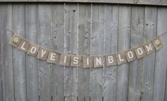 LOVE is in BLOOM with Daisies on ends - Burlap Wedding Banner Garland- Spring Garden wedding, Shabby chic Outdoor Barn, Farm, Photo Props.. $29.00, via Etsy.