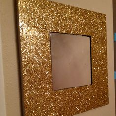 Mod Podge and glitter on an old mirror. This would be cute on one of those cheap wall mirrors from Target!