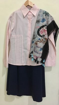 Black skirt with pink shirt and black hijab
