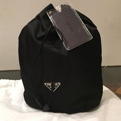 Prada Drawstring Makeup Pouch- Black Prada Vela drawstring cosmetic pouch in black. Brand new with tags and dust bag. Prada Bags Cosmetic Bags & Cases
