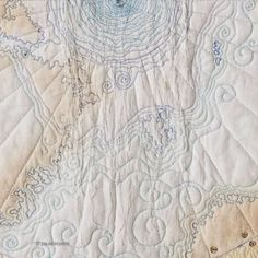 Global warming, the great unraveling map art quilt by Paula Kovarik