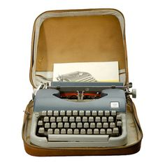 Produced in the 1950s or '60s, this Smith Corona typewriter is protected by a retro-chic canvas case.  Product: Typewriter