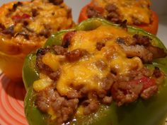 Low Carb Cheesey Stuffed Peppers Recipe: 6-8 green, orange, or yellow bell peppers 1-2 pounds ground beef 1 medium white onion, chopped 1 large can of diced tomatoes 2 garlic wedges, minced 1 cup of cheddar cheese Salt and pepper to taste