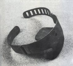 """This device stifles the screams so as not to disturb the conversation of torturers. The iron ""box"" on the inside of the ring is forced into the victim's mouth and the collar fastened behind their neck. A small hole allows the passage of air but this can be stopped up by a touch of the executioner's fingertip, producing suffocation."""