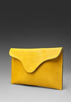 this envelope clutch has my name written all over this nice yellow leather.