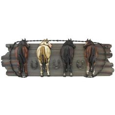 """Hang coats, hats, scarves, purses and more with this humorous Four Horse Hooks on Wood Plaque! The wood and resin plaque is great for accenting western-themed décorand features the back-sides of four horses, each with their heads turned to the front.        Dimensions:      Length: 7 1/2""""    Width: 22""""    Projection: 2 3/4"""""""