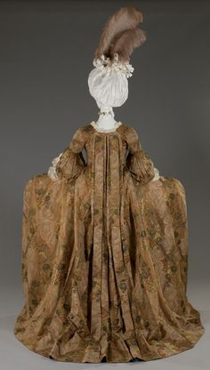 The feminine dress from ceremony, andrienne or robe à la française  The andrienne or robe à la française, female dress typical of the 18th century is characterized by a broad monumental, line the hips from rigid substructure. Loose folds back down from the neckline to form a train.