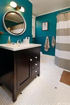 Bathroom: petrol (walls) - wood (furniture and doors) - white (wall tiles, porcelain) - black or dark grey (checkered tiles for the floor). by malinda