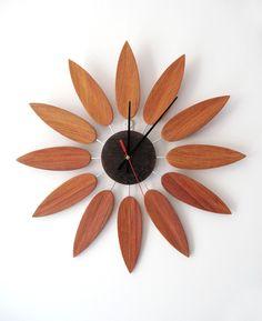 handmade annatto clock wood wall clock  red sanders clock sunflower shape clock art clock  028. $105.00, via Etsy.