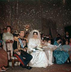 Mohammad Reza Pahlavi, Shah of Iran, is seated next to her third wife Farah Diba on the day of their marriage; her gown is by Yves St Laurent and on her head a Noor-ol-Ain Diamond tiara. Iran, 21st December 1959.