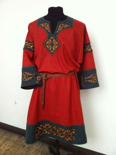 Red wool tunic decorated with quilted cut work bands and placket. Beautiful enough for a lady, but tis man's garb.
