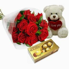 hree ways to the heart of your loved one; tempting Ferrero Rocher chocolates, an adorable white teddy bear complete with heart that declares 'I Love Y Cheap Anniversary Gifts, Personalized Anniversary Gifts, Online Birthday Gifts, Online Gifts, Spas, Traditional Anniversary Gifts, Rose Delivery, White Teddy Bear, Birthday Roses