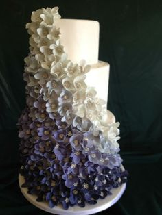 Purple Ombre Wedding Cake. I want this in pale blue with slightly less flowers.This is beautiful