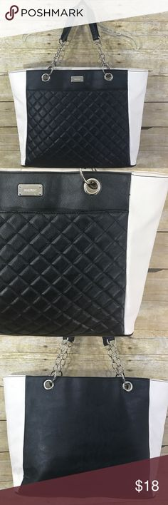 """Nine West LARGE Tote Faux Leather Black Cream Nine West LARGE Tote Cary-all Faux Leather Black Cream Silver Hardware Purse   📌SIZE: Large  📌Measurments: H:12"""" L:19"""" Strap Drop: 8"""" Bag Depth: 5""""  ✅Condition Notes: Excellent Used Condition! Hardly any wear on the outside of the tote. Small pen mark/stain on the inside of the tote on one of the pockets. Thank you.✅ Nine West Bags Totes"""