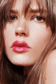 How-To: For a fresh, glossy red lip start with a berry base, before removing most of it just to leave a stain. Then cover with Glossier Cherry Balm Dotcom to kick up the red tones.