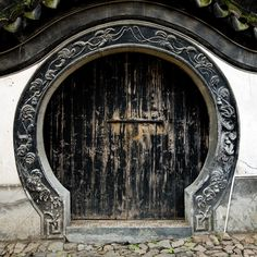 Traditional round door in Tongli, Wujiang county, on the outskirts of Suzhou, China.