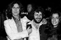 "Currently for sale on eBay: George and Olivia posing with a guest at a Thirty-Three & 1/3 promotional event, Boston, Massachusetts, 16 November 1976. Photo: unknown. The eBay listing: here. "" ""All the..."