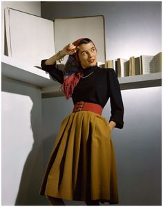 camel-coloured wool skirt with a wide red belt   Horst, 1941