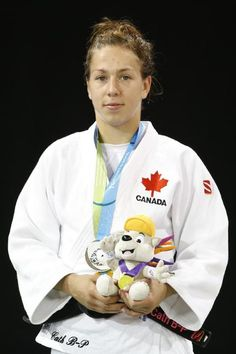 July 12 - Judo - Women's - 57 kg.  Canada's Catherine Beauchemin-Pinard wears her medal earned during the women's -57kg gold medal judo division at the Pan Am Games, Sunday, July 12, 2015, in Mississauga, Ontario. (AP Photo/Jul