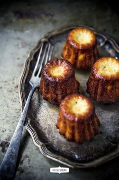 Cannelés - A small French pastry with a soft and tender custard center and a dark, thick caramelized crust.