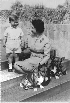 Queen Elizabeth II with two of her favorite things: Prince Andrew and her corgis.