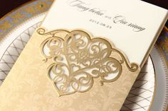 Wedding invitation card - golden and laser cutted #weddinginvitation