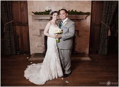 Bride and groom pose for formal photos in front of the fireplace in the College Room of the University Club of Denver in Colorado. - April O'Hare Photography http://www.apriloharephotography.com #DenverWedding #UniversityClub #UniversityClubofDenver #DenverUniversityClub #DenverWedding #DowntownDenverWedding #ColoradoWedding #DenverWeddingPhotographer #IndoorWedding #CityWedding #IndoorWeddingFormals #CollegeRoom #FormalWedding