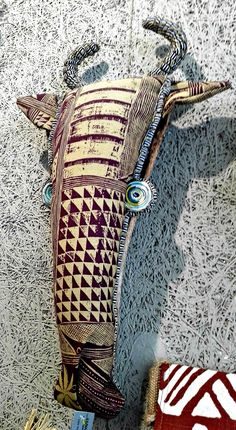 Shop our collection of textile hunting trophies. These unique trophy-style designs feature African animals including Antelope, Elephant, Giraffe and Zebra. Handmade in South Africa from hand-printed fabrics and organic materials. Hand Printed Fabric, Printing On Fabric, Giraffe, Elephant, Faux Taxidermy, African Jewelry, African Animals, Craft Stores, Jewelry Crafts