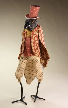 crow doll in red cream