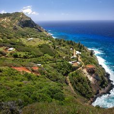 Adamstown, seen here from Ships Landing, is Pitcairn Island's only village. Coastalliving.com