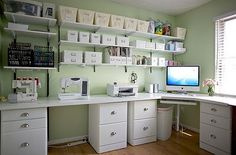 Dry As Toast: Beautiful Work Spaces  I absolutely LOVE this one! White furniture with a pop of color on the wall! The iMac in the corner near the window for natural light, the vas of flowers, the printer is close but not too close, the drawers the desk top is sitting on for organizing paperwork etc, the floating shelves with all of the super organized baskets/boxes, jars, etc.! I LOVE love love how organized and clean this looks! Oh and I love the wood floor! :D