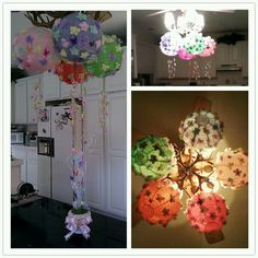 Butterfly themed babyshower lanterns. I hot glued the remaining butterflies from my centerpieces and hung some baby pacifiers from the middle. They were really cute hanging from the middle of the canopies at the actual party. They are just hanging in the kitchen in these pictures.