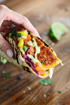 Maple Chipotle Salmon Tacos with Mango Salsa - Quick and easy fish taco recipe with a touch of sweet and spicy seasoning served with a fresh fruit salsa. | jessicagavin.com
