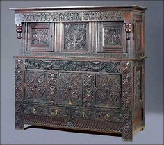 Furniture Styles - A Jacobean Joined Oak Press Cupboard, Part 17th Century, Dated 1689, Sold at Christie's September 7-8, 2005 - very similar to my cupboard...