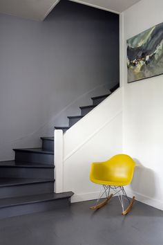 Eames rocking chair and a lovely painting. And those stairs!