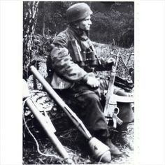A German Fallschirmjäger rests his feet while sitting on a fallen tree. Note how well armed he is, two Panzerfausts and the deadly STG-44/MP-44.  1944.  The STG-44 or MP-44, whatever, only went into mass production in 1944 and supply never came close to equaling demand. Despite their high priority most Fallschirmjäger ended up with the standard K98k bolt action rifle rest of the war. Pin by Paolo Marzioli  #ww2 #wehrmacht #luftwaffe #fallschirmjäger #stg44 #mp44 #panzerfaust #paratrooper