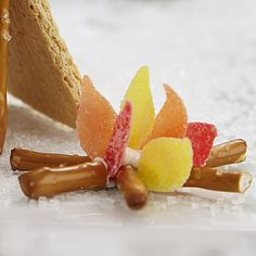Spice Drop Campfire - Build a roaring campfire for your gingerbread house setting using easily accessible ingredients: spice drops, pretzel sticks and royal icing.