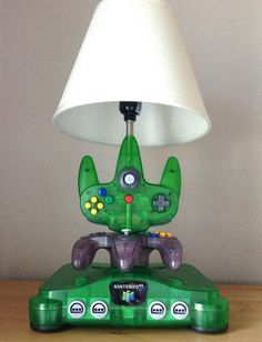 This is a very unique lamp sculpture I made using a rare Atomic Green Nintendo 64 console and 2 controllers one Atomic Green and one Atomic Purple.