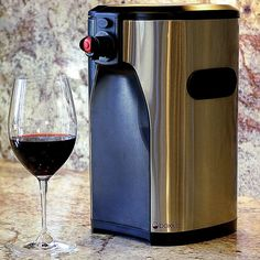 Serve boxed wine in style without worrying about messy drips and spills with the Boxxle box wine dispenser. Made from durable black plastic, this wine dispenser also features stainless steel accents and an attractive design that matches any kitchen decor.