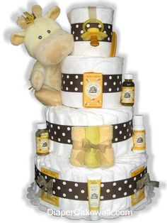 Unisex diaper cake for everyone that is three tiers with ribbons and plush toy. #diapercakes