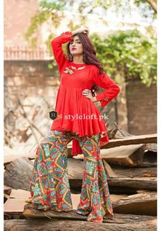 Red Rayon Flared Peplum Top with Handmade Bows and Ribbon Flowers on Neckline, Printed Lawn Gharara Pants and Net Dupatta. Pakistani Fashion Casual, Pakistani Dress Design, Pakistani Outfits, Indian Fashion, Pakistani Frocks, Frock Fashion, Fashion Dresses, Stylish Dresses, Casual Dresses