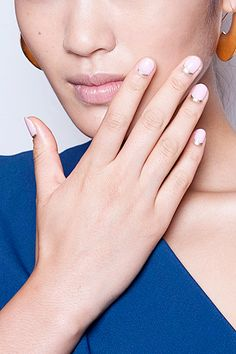 If you love ladylike nail art, check out this design at Cushnie et Ochs: a baby-pink hue accented with a reverse French manicure. Instead of the typical white, silver flicks sit just above the cuticles.