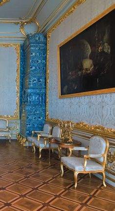 The pantry belonged to the personal apartments of the Empress in the Catherine Palace and until 1761 formed part of the Dressing-Room of Empress Elizabeth. In the mid-1800s the room was divided by a white damask partition, behind which a servants' pantry was arranged during dinner parties.  The present interior of the Pantry has been completely restored after the wartime destruction. The walls are lined with white cloth in carved and gilded frames.