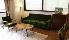 綠菱格紋沙發配木地板效果不錯捏