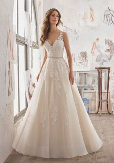 2017 Designer Wedding Dresses and Bridal Gowns. This A-Line Bridal Gown has Crystal Beaded Lace AppliquéŽs on Organza and A Stunning Illusion Keyhole Back